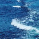 Photograph of a blue and white sea wave.